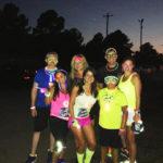 Paula Smith and friends running at night
